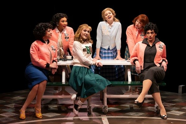 Pink Ladies at a table in Grease